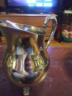 Sterling Silver Pitcher And Bowl