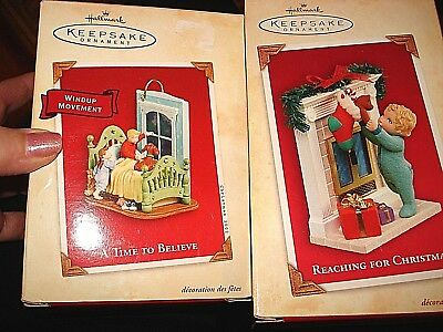 Hallmark Reaching For Christmas /A time to believe Ornament lot of 2 2004/2002