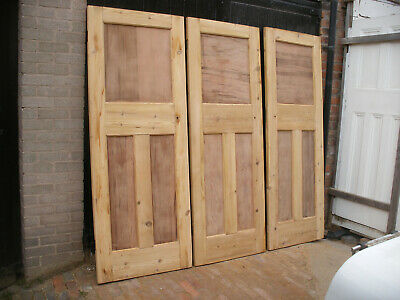 Reclaimed 1930s 1 over 2 panel stripped pine doors.