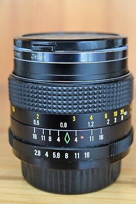 Super Paragon PMC 28mm f/2.8 lens with Photax 1a 52mm filter