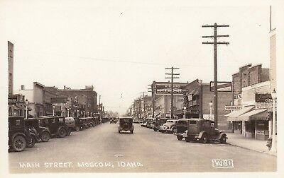 Rppc Main St. Unbelievable Stores Car Truck Advertising Moscow Id Idaho Postcard
