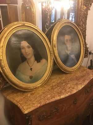 A Pair Of Large Oval Antique Oil Portraits In Gilt Frames