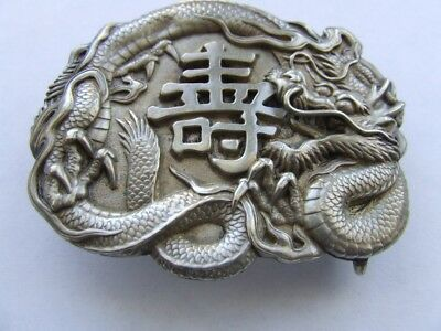 Vintage Japanese Dragon buckle tests silver, with sign of longevity