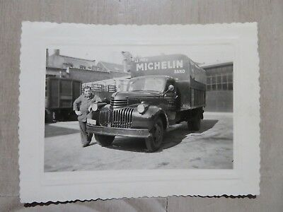 very old picture of a Truck MICHELIN Tires Pneu Band with a Soccer Team player