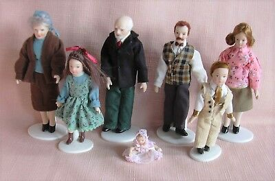 A Set of 7 PORCELAIN DOLLS & 6 DOLL STANDS Modern Style by Vanity Fair 12th
