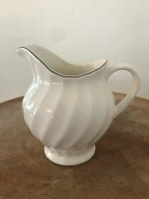 Ironstone creamer with intricate detail.  Vintage!