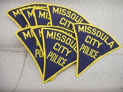 Trader lot of 8 old style Missoula, Montana patches - free postage