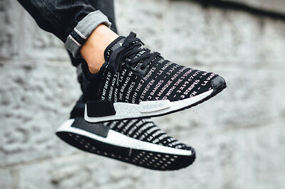 4eb934742a65 Adidas NMD R1 Nomad Boost The Brand With 3 Three Stripes Blackout Black  S76519
