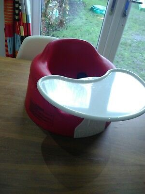 Red Bumbo baby seat with Tray and safety straps