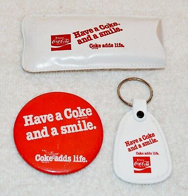 3 Vintage Have A Coke And A Smile Items Pinback Button, Keychain, Rain Poncho
