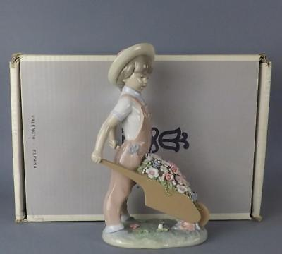 An Exquisite Porcelain Spanish Lladro Figurine of a Young Boy.