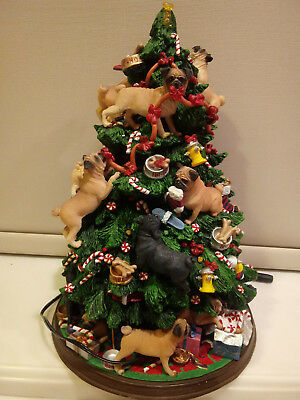 "The Pug Christmas Tree by Danbury Mint, 25 pugs decorating the tree, 13"" tall"