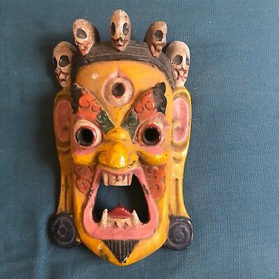 wooden tribal folk mask from India in yellow