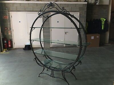 antique solid metal and thick glass vintage bookcase
