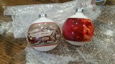 2 collectible hallmark glass ornaments  Currier and Ives and Santa