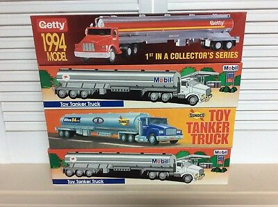 Lot of 4 Toy Tanker Trucks. Getty, Sunoco and Mobil