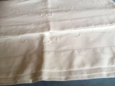 Pair of white embroidered vintage pillowcases with raised white embroidery