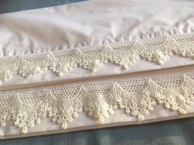 Pair of vintage style white cotton pillowcases with a pretty floral lace edge