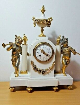 Antique french Gilt Metal and marble Figural mantle clock