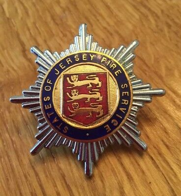 An old original, States of Jersey Fire Service, cap badge.