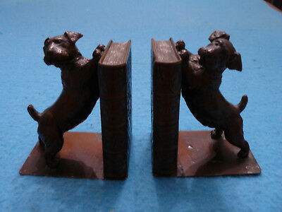 A pair of dog themed art metal bookends, terrier and books