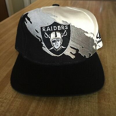 c008d7b72deab9 Vintage Oakland Raiders NFL Pro Line Logo Athletic Splash Snapback Hat 90s