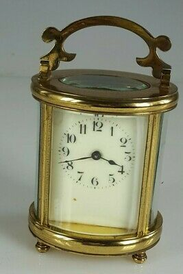 Antique Oval  brass cased carriage clock