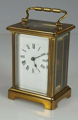 French four glass brass case carriage  Clock
