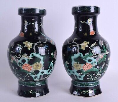 A PAIR 19TH CENTURY CHINESE FAMILLE NOIRE PORCELAIN VASES bearing Kangxi