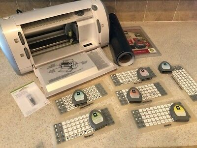 Cricut Die Cut Machine (original version) and 7 cartridges + vinyl & new blade