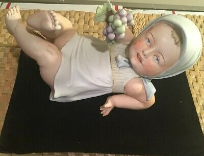 Antique Heubach Baby Girl Laying On Her Back W/ Grapes In A Hood 11 In. long