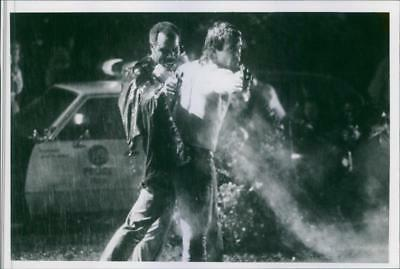 Danny Glover and Mel Gibson are acting together in a movie scene - Vintage photo