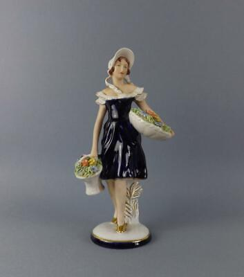A Exquisite Art Deco Porcelain Royal Dux Large Figurine of Girl with Flowers.