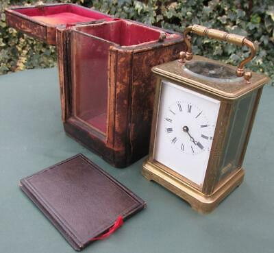Nicely chased 19th century brass French Carriage clock keeps time case