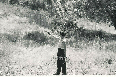 Lady SHOOTING a GUN into the distant ground cover* old HUNTING Photo