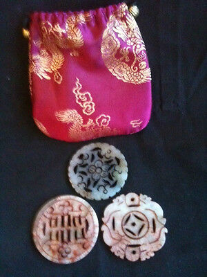 3x SOAPSTONE BI DISCS IN SILK POUCH - PROVENANCE & AGE UNKNOWN