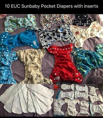 Cloth diaper lot (33 diapers) various brands with wet bags and snapppies