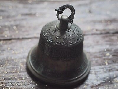 old antique bell with a part broken dragon holder Myanmar temple
