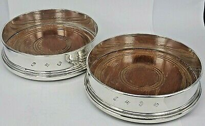 Pair of large silver wine bottle coasters for fine dining table bold hallmarks