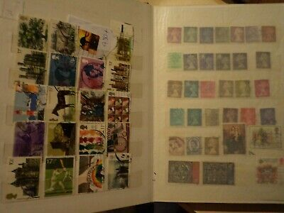 blue MEDIUM HINGELESS STAMP ALBUM   WORLD COLLECTION- 480 approx USED STAMPS.