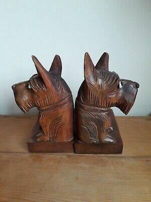 Wooden Scotty Dog Bookends, Black Forest Art Deco Era. 17 cm.high, Glass Eyes