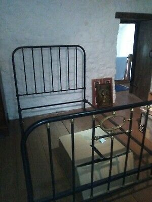 Antique iron and brass French double bed frame.