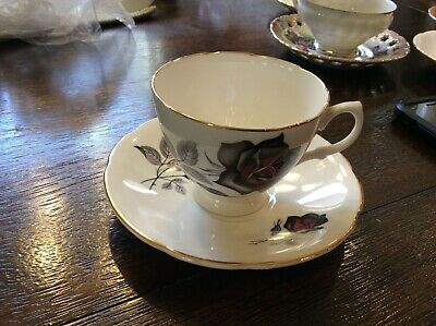 "Vtg England made BONE CHINA CUP AND SAUCER WITH LARGE ""BLACK ROSE ""GOLD TRIM"