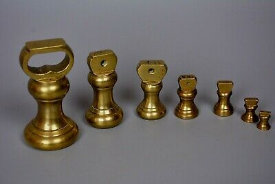 A Collection of Brass Kitchen Scale Type Weights 1/4 Oz to 1lb