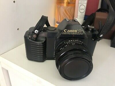 Canon T50 35mm FD Film Camera, 35-70mm Zoom Lens, flash, camera case, manual.