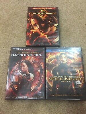 The HUNGER GAMES, CATCHING FIRE, And  Mockingjay Part 1. 3 DVD Lot