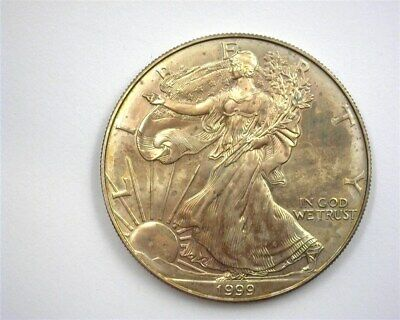1999 Silver Eagle Dollar  Near Perfect Uncirculated Rainbow Toning