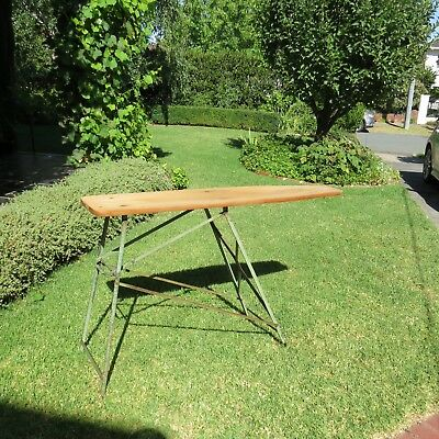 Classic, antique, collectible, ironing board. Shop display.