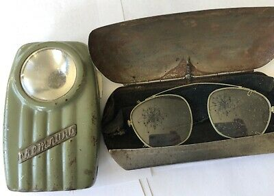 antique lot of two: eye glasses and flash light
