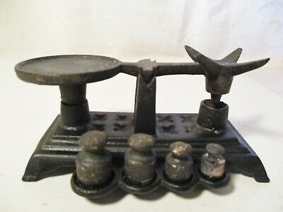 Vintage Small Black  Cast Iron Balancing Scale With Four Weights